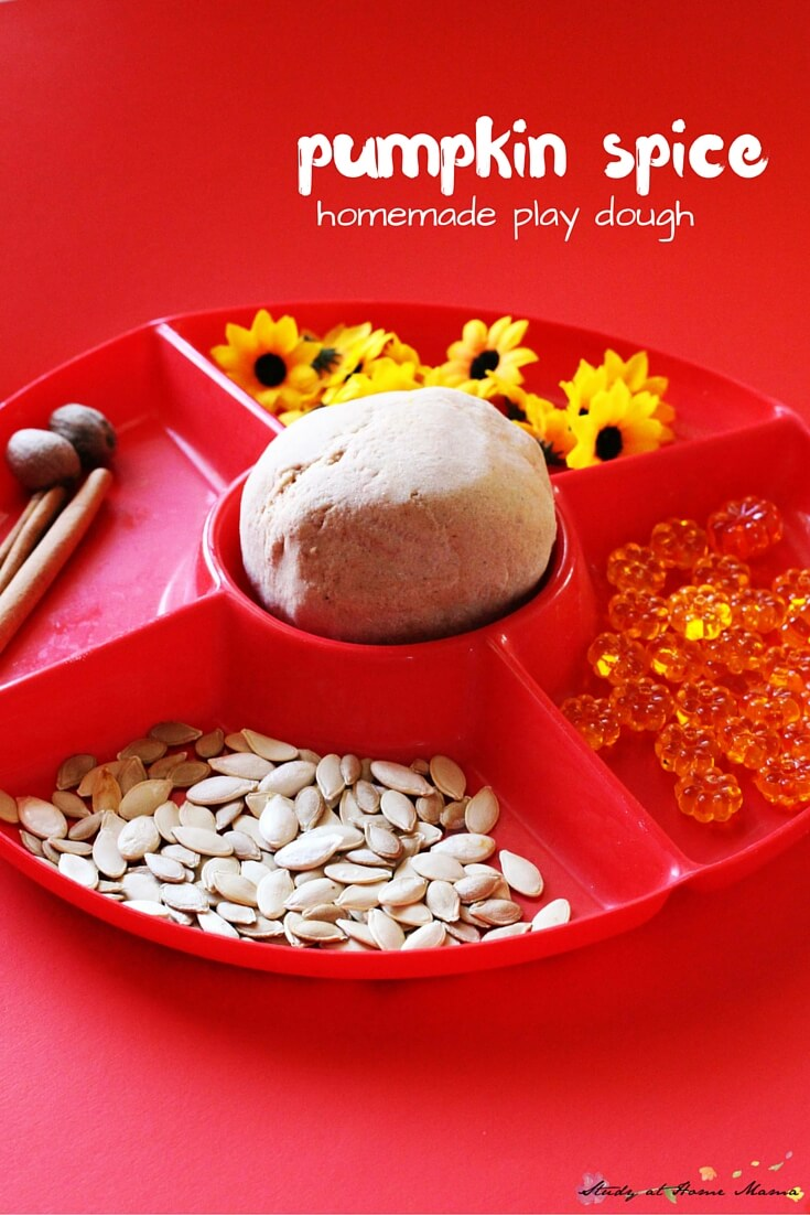 Pumpkin Spice Play Dough - easy homemade play dough recipe used in a pumpkin patch play dough invitation. A wonderful and amazing smelling fall sensory activity for kids.