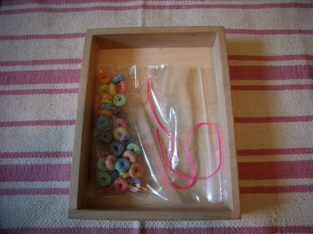 Froot Loops Necklace tray, one of many Montessori-inspired St Patricks Day Activities for Toddlers