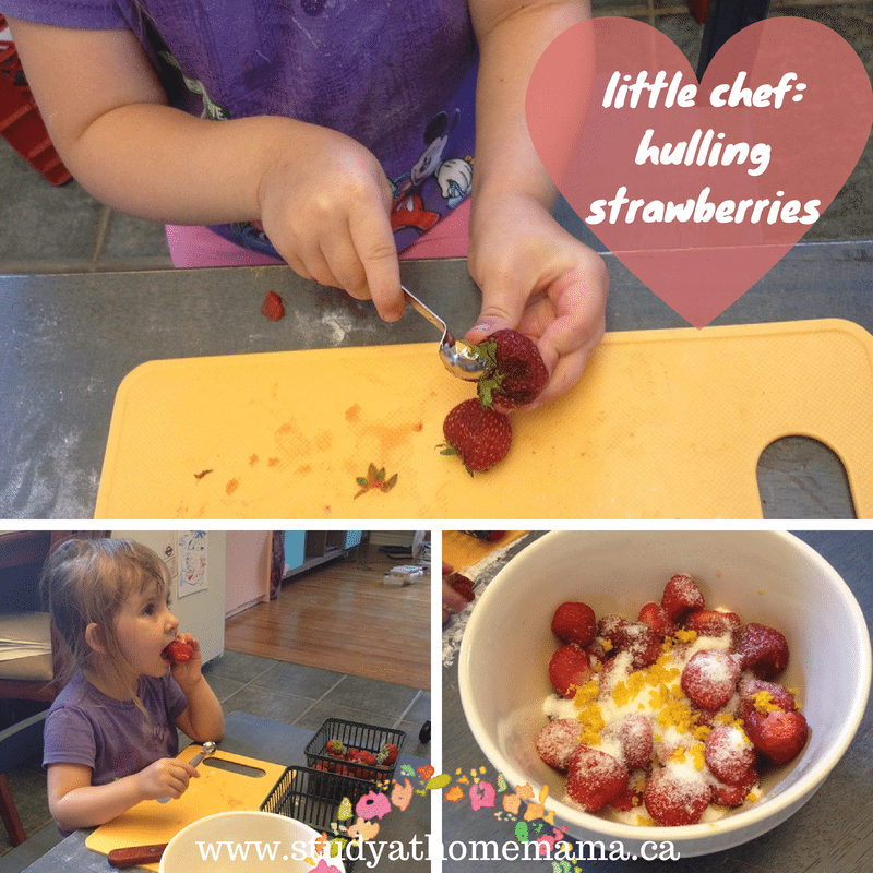 little chef: hulling strawberries at  Sugar, Spice and Glitter #kidsinthekitchen #littlechef