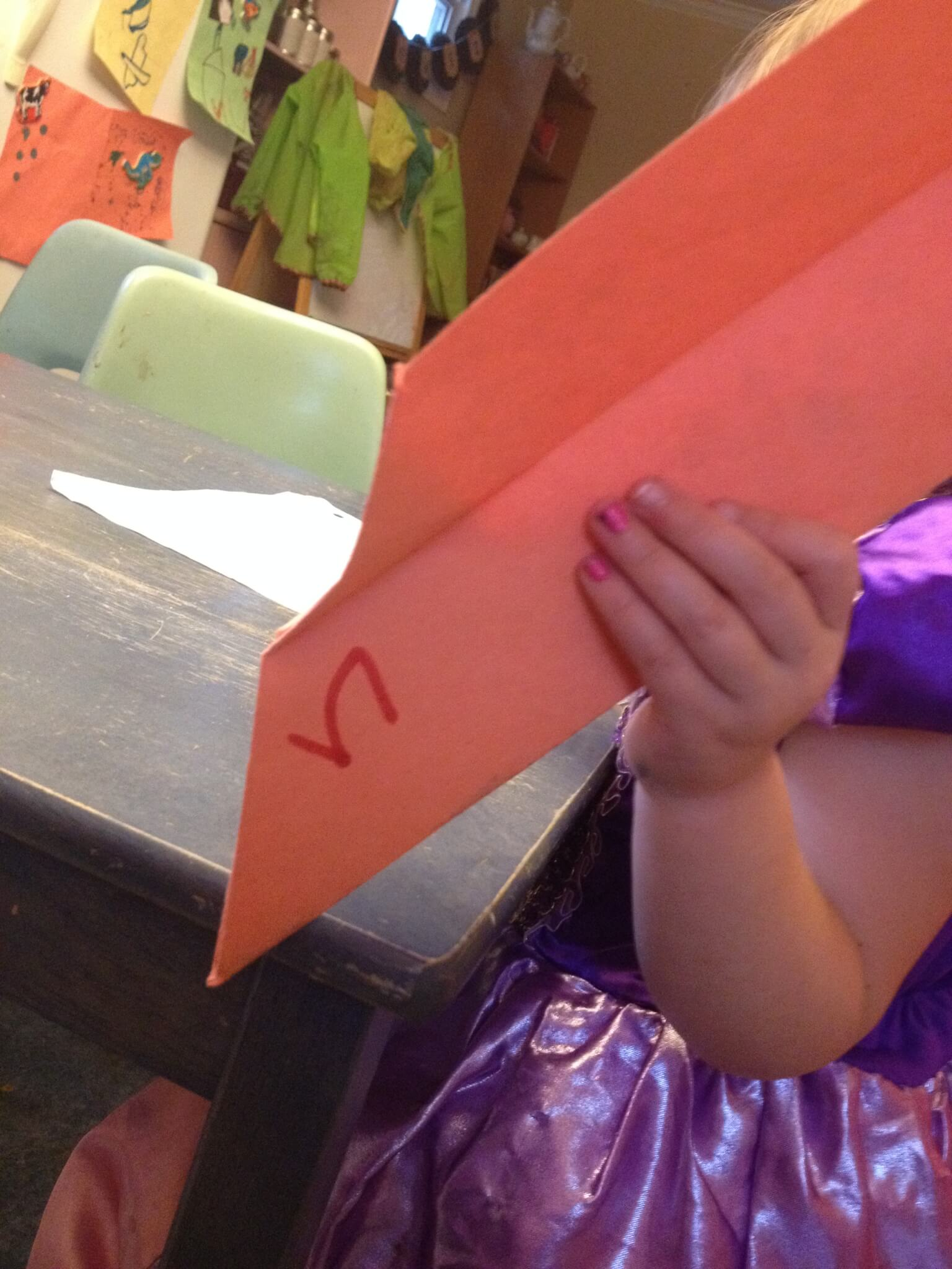 "making paper airplanes for learning the letter ""n"""
