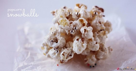 Kids Kitchen: Popcorn Snowballs, a cute winter snack for kids to make and eat! These fun popcorn balls are given a frosted touch with some sugar crystals or silver dracon balls
