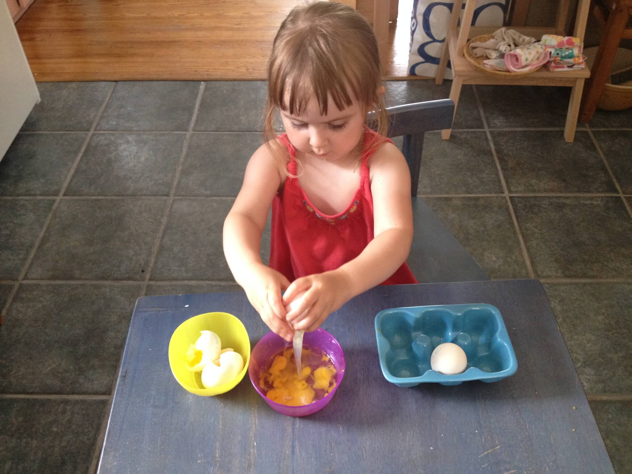 Making green eggs after reading Dr. Seuss's green eggs and ham