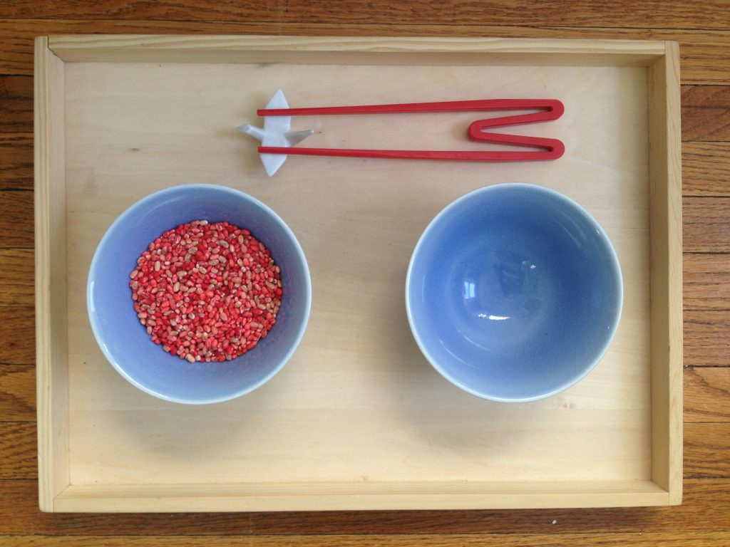 Montessori Practical Life: Chopstick Exercise - check out this blog to see all of the Montessori practical life lessons, including the spooning activities