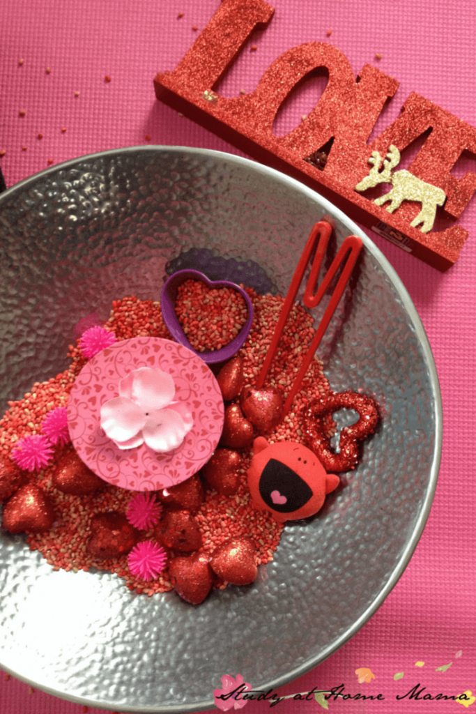 Valentine's Day Sensory Bin for Toddlers, a fun fine motor exploration of love and hearts!