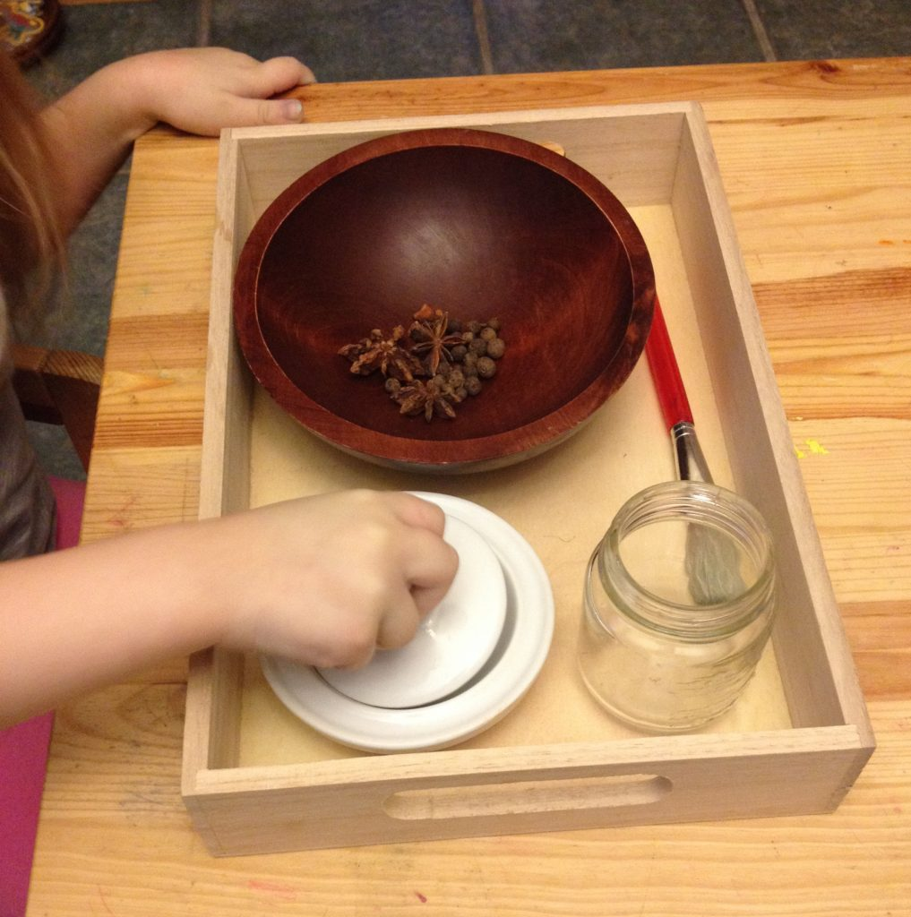 montessori practical life lesson in grinding spices