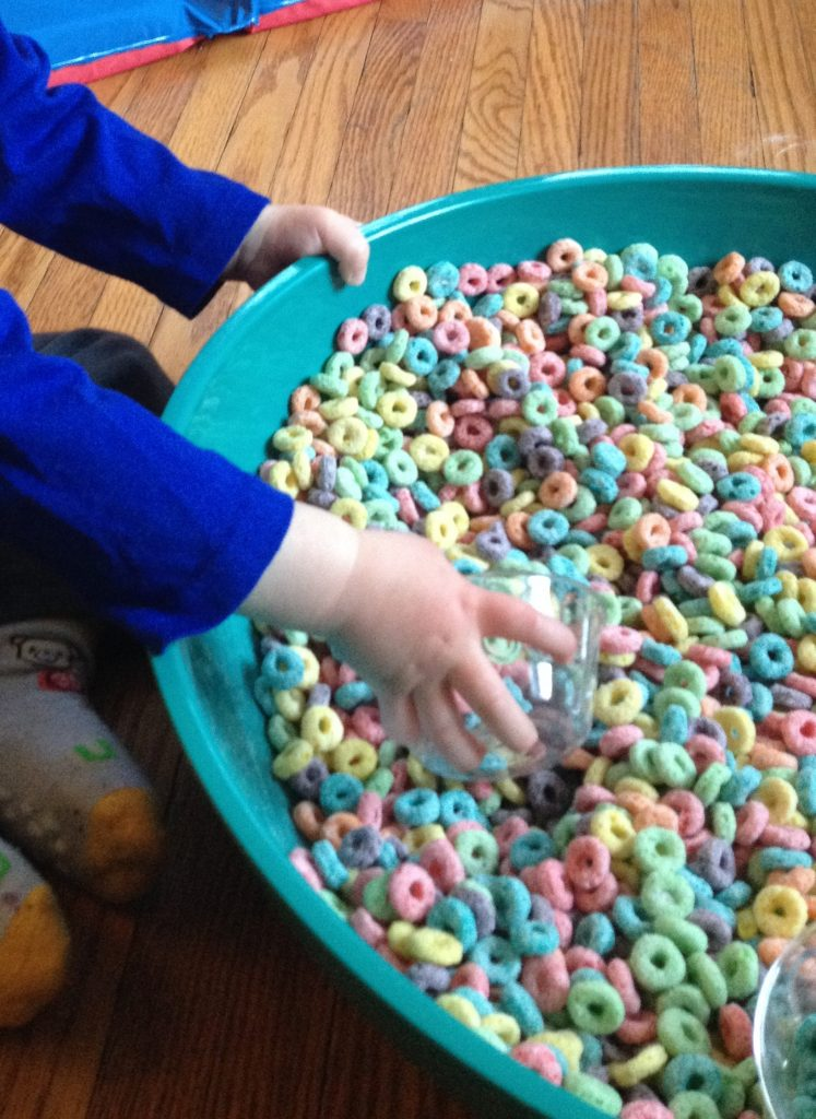 Cereal Sensory Bin: froot loops scooping, part of 7 ways to play with Froot Loops