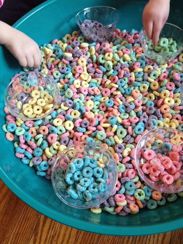 Sorting Froot Loops by colour to make an Edible Rainbow Sensory Bin