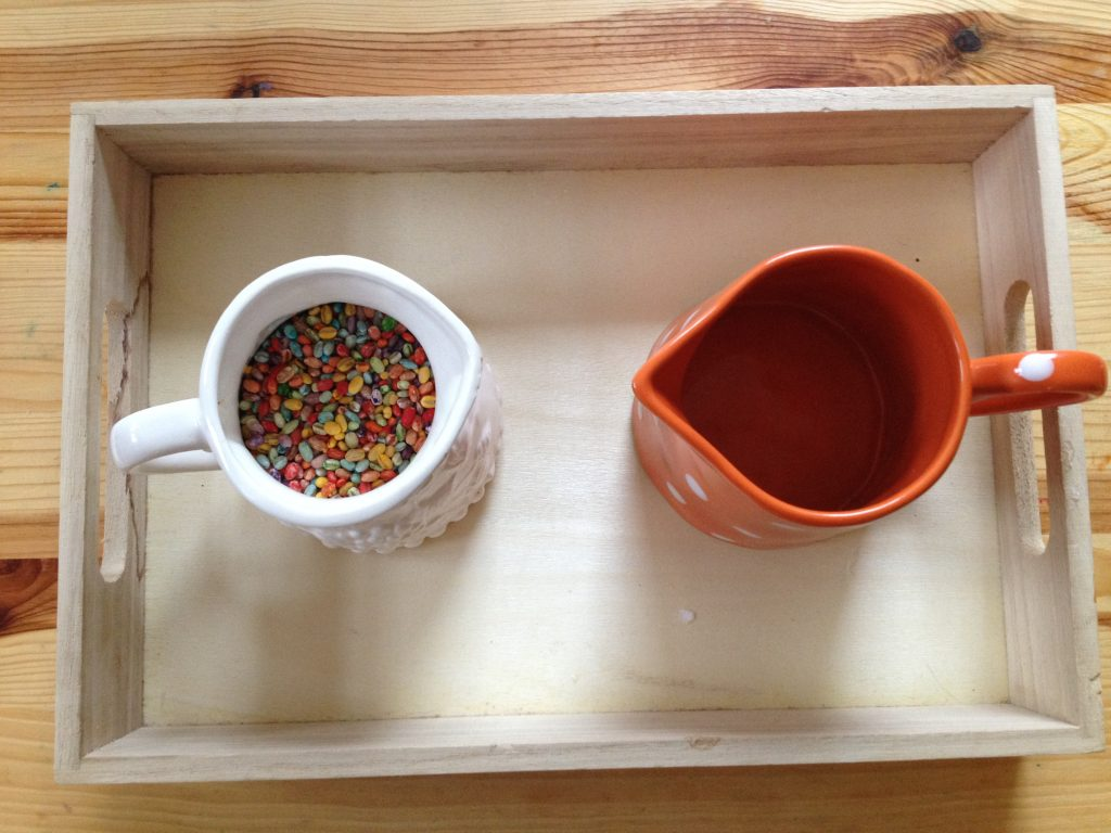 Montessori Practical Life Lesson: We used rainbow coloured barley to practice dry pouring, an essential Montessori practical life skill
