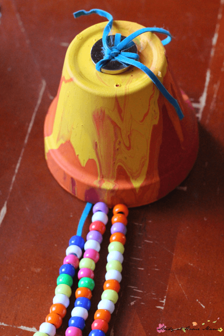 How to make an easy garden wind chime with kids - using pour painting and hand-strung beads