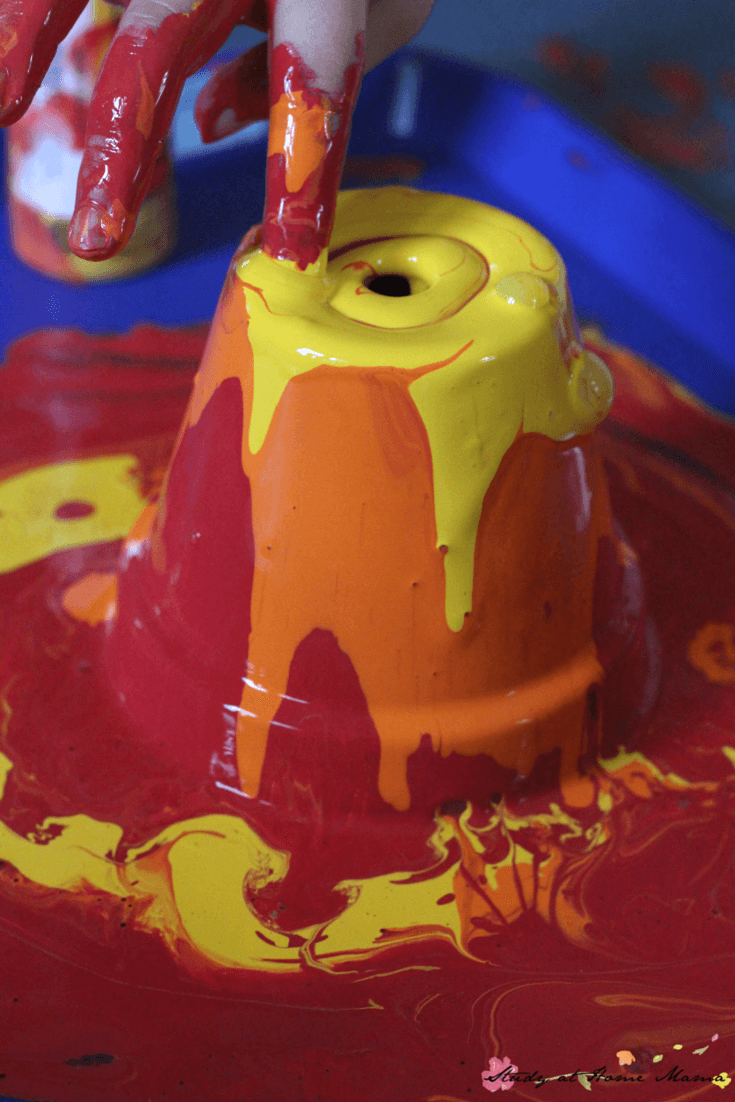 Getting messy with pour painting! A great process-based kids art activity