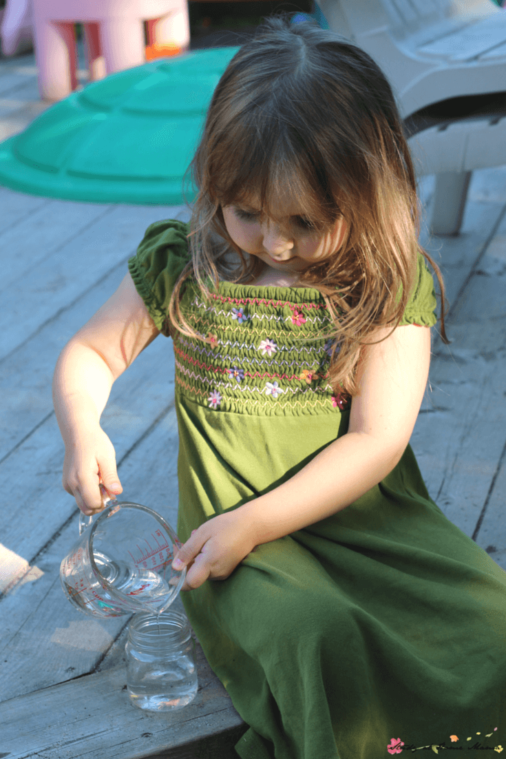 Pouring out water for our kids kitchen science experiment