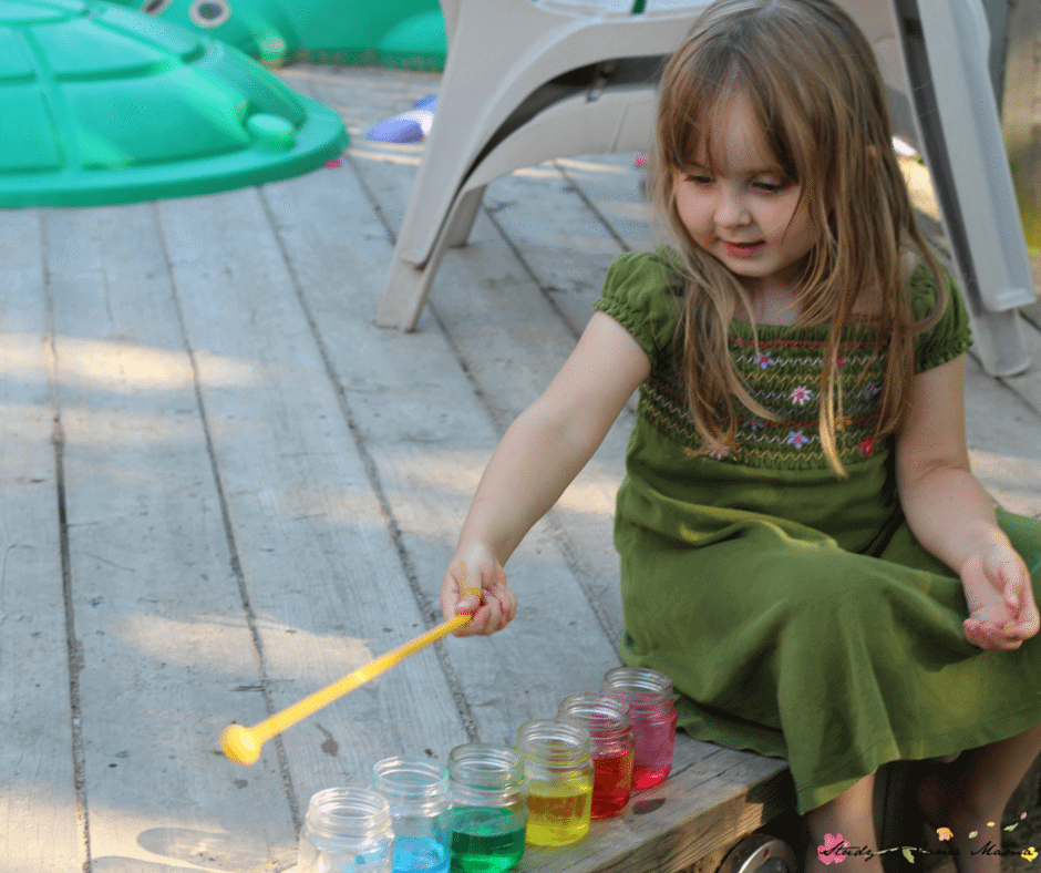 Playing with our water xylophone - a great way to mix music, science, and sensory activities for kids!
