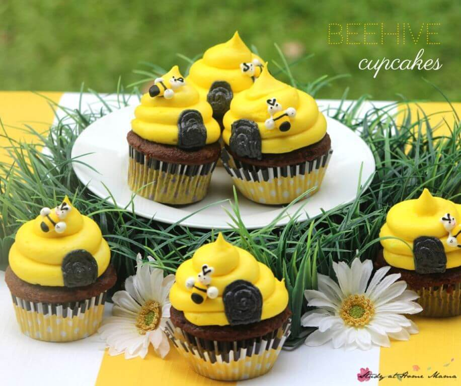 Cute Beehive Cupcakes - perfect for a Bee Themed Birthday Party. An easy chocolate cupcake topped with a honey-touched buttercream frosting, these sweet birthday cupcakes are simple and fun.
