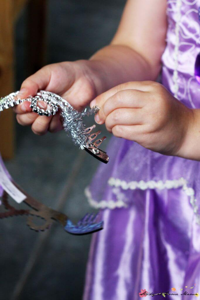 Wrapping the sparkly pipe cleaner around the tiara to make a mermaid tiara craft is a great fine motor activity and can keep children's hands busy