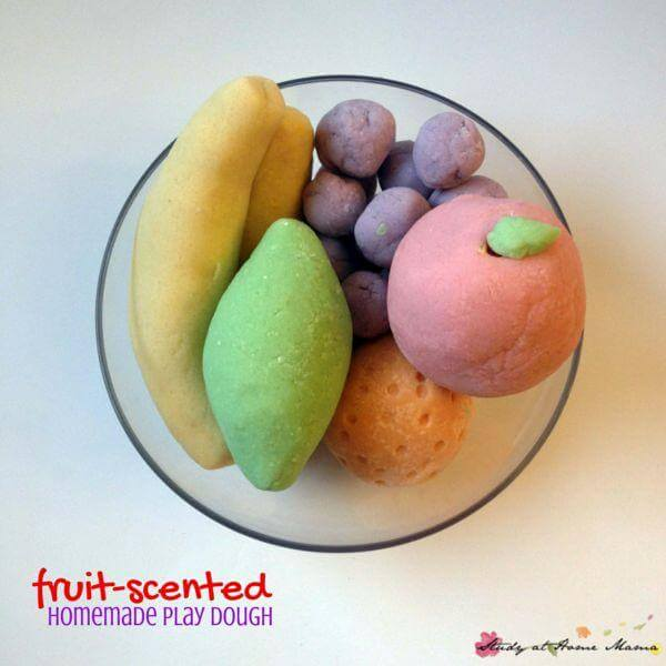 Fruit-Scented Homemade Play Dough - an easy recipe you can make with ingredients you already have on hand, no special trips to the grocery store required. Homemade play dough is a great sensory activity for kids, especially when you add fun colors and scents into the dough. Includes a free homemade play dough recipe