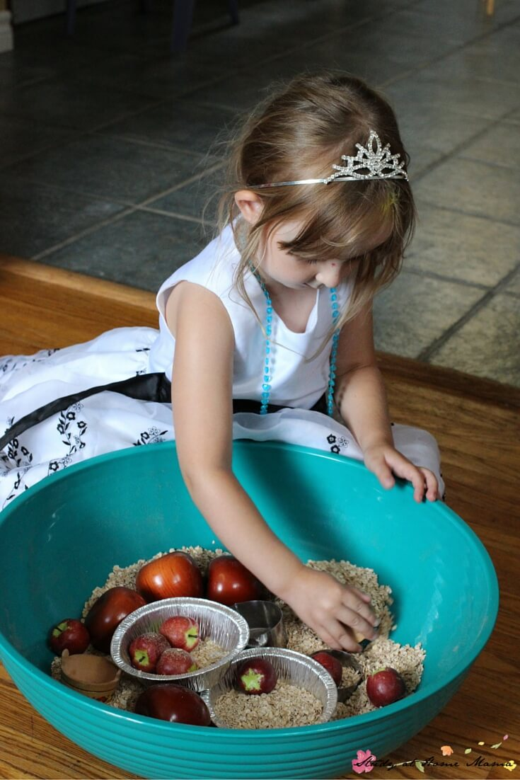 Encourage children to practice counting, fine motor skills, and descriptive language with this fall-themed sensory bin for an apple pie