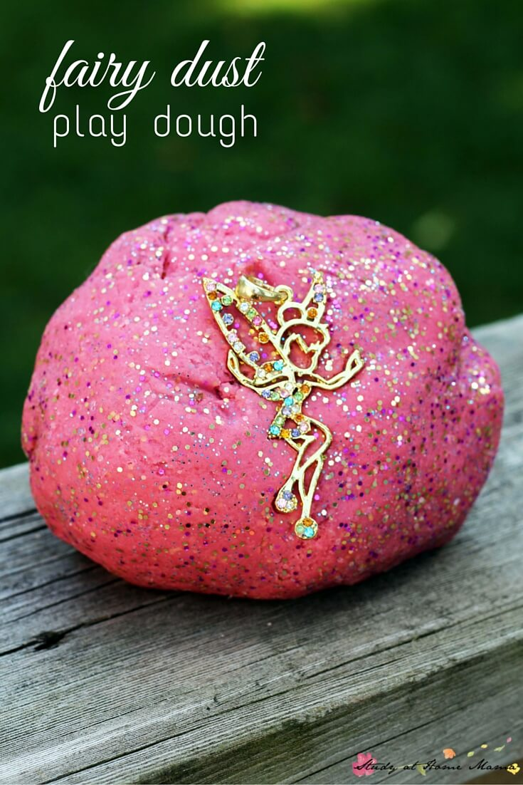 Fairy dust play dough - the perfect sparkly play dough for fairy pretend play. An easy homemade play dough recipe for sparkly play dough kids will love! Would make a great Peter Pan or Tinkerbell party idea