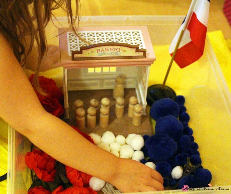 A fun Madeline sensory bin - laid out like a French flag and incorporating many symbols of French culture