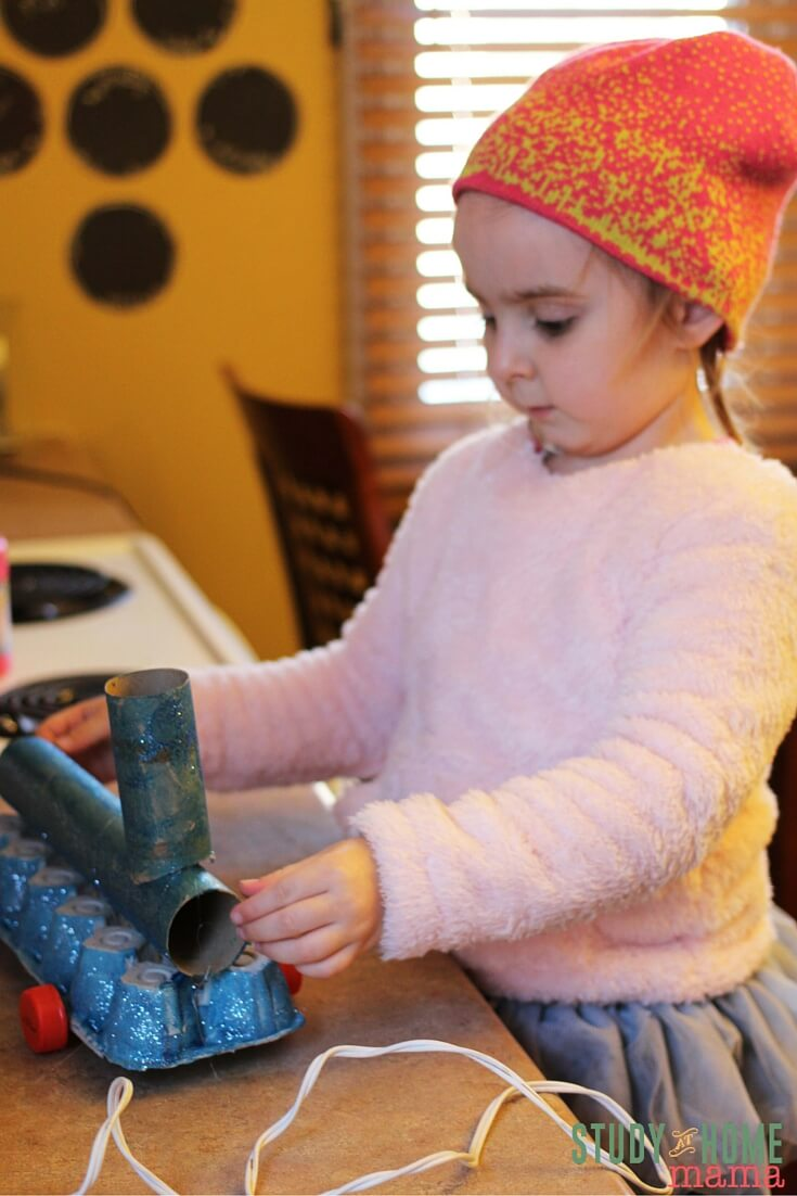 Building a functional train with moveable wheels and then figuring out self-propelling mechanisms is a great STEAM activity for kids