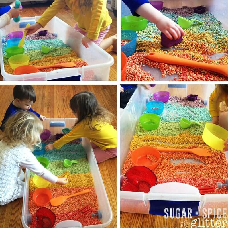 This rainbow sensory bin is made from dyed pearl barley - a perfect rainbow sensory activity for St Patricks Day
