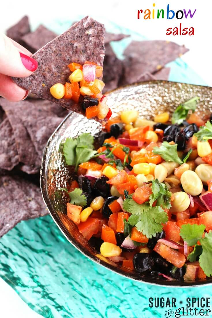 A healthy rainbow recipe your whole family will love! This fresh rainbow salsa lets your kids eat a rainbow of vegetables, while also being an easy healthy snack the grown-ups will love, too!