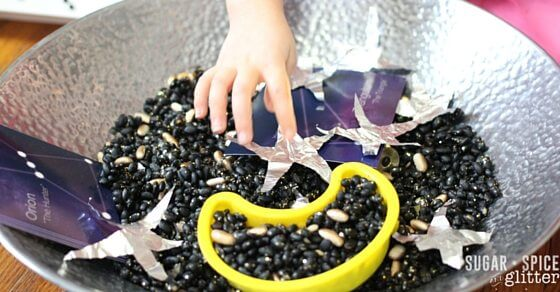 astronaut sensory bin - making a constellation with our space sensory bin
