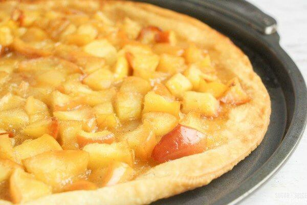 This apple pie pizza is cooked and ready for some garnish