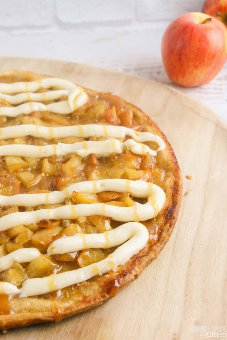 How to make a fall dessert pizza - apple pie topping, cream cheese frosting, and caramel drizzle on top of an easy butter pastry