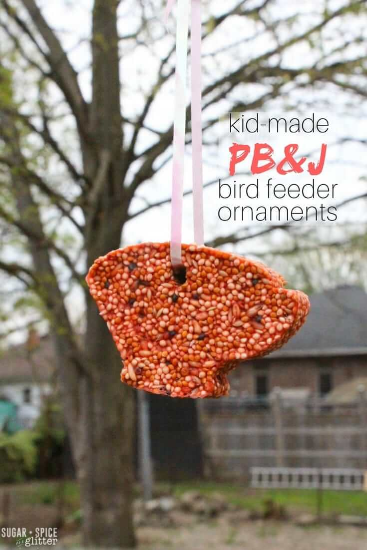 How cute are these kid-made bird feeder ornaments made in cookie cutter shapes! This recipe is super easy for kids to take the reigns with - and veterinarian-approved
