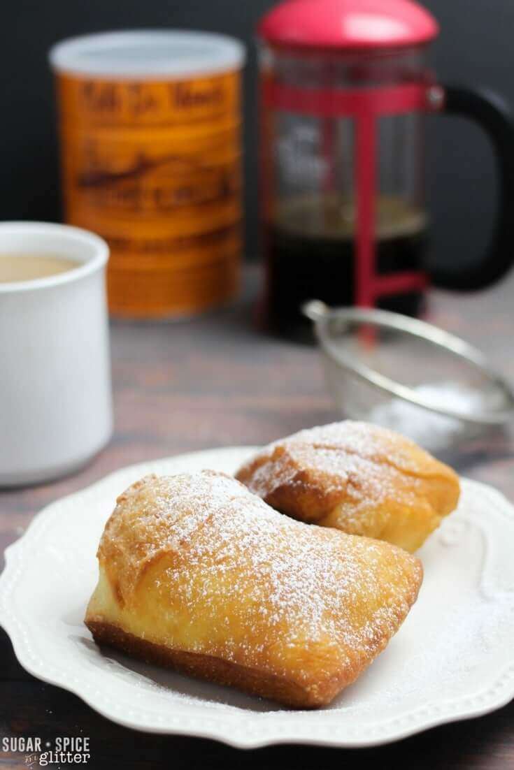 Light, crispy and chewy beignets just like you can find in New Orleans. This easy and authentic recipe will make you feel like you're sitting right on Bourbon Street at the famous Cafe Du Monde.