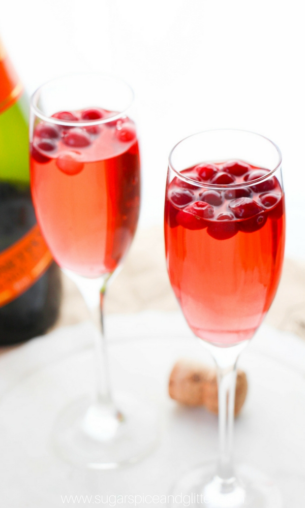 Cranberry Mimosa perfect for Thanksgiving or Christmas brunch - or any special fall occasion! Using cranberry ginger ale, this cranberry cocktail recipe is fizzy and unexpected treat