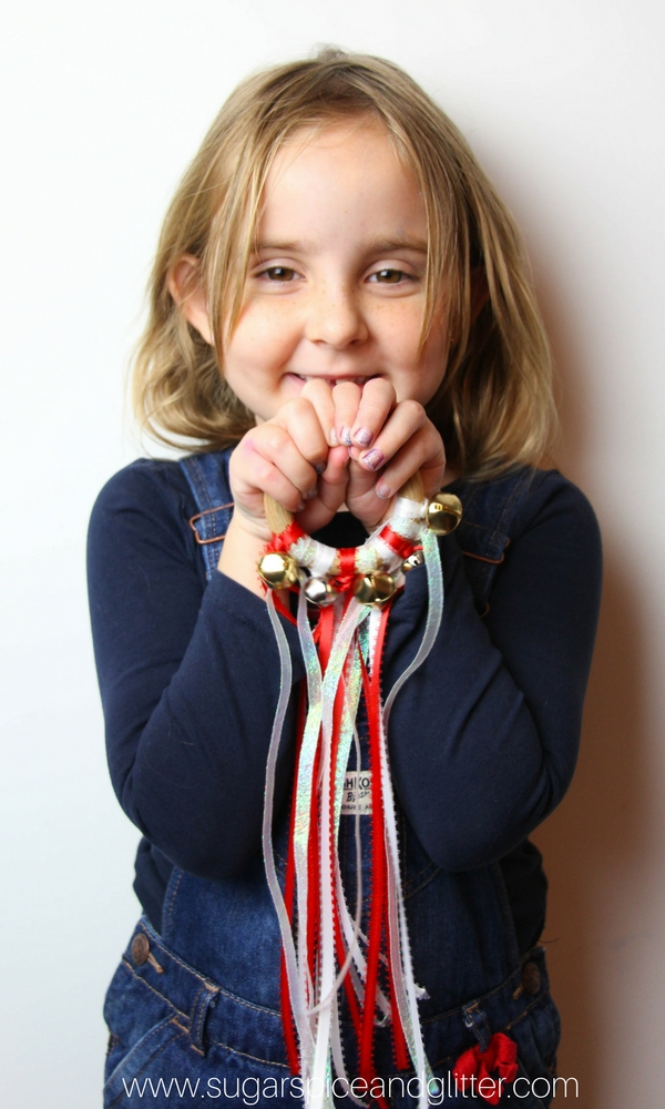 How sweet is this simple handmade Christmas Jingle Bell craft for kids? A Waldorf Hand Kite that comes together with just three materials