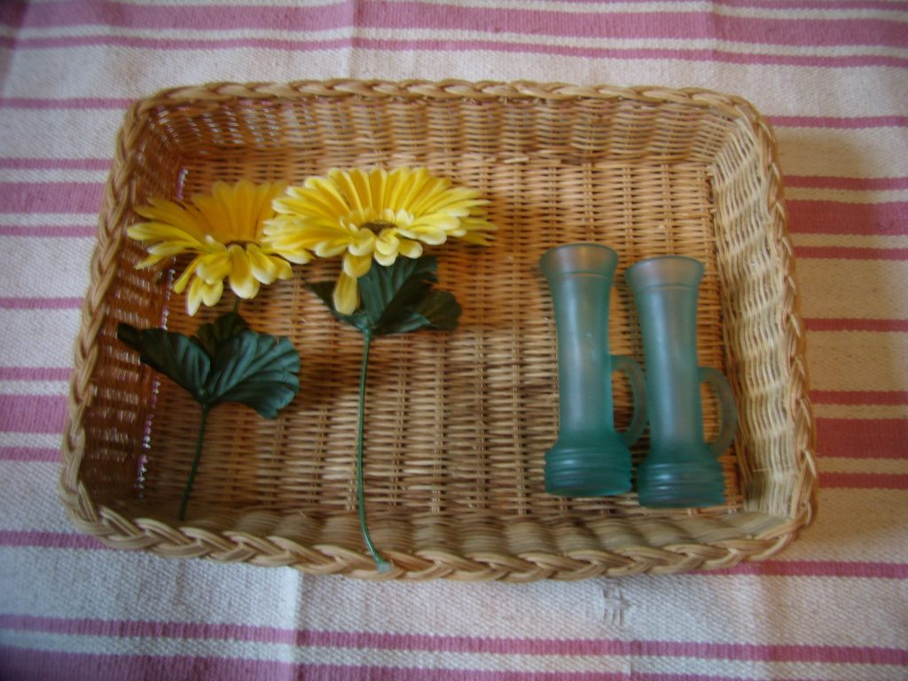 Flower arranging and one to one correspondance for Montessori-inspired Toddler St Patrick's Day trays