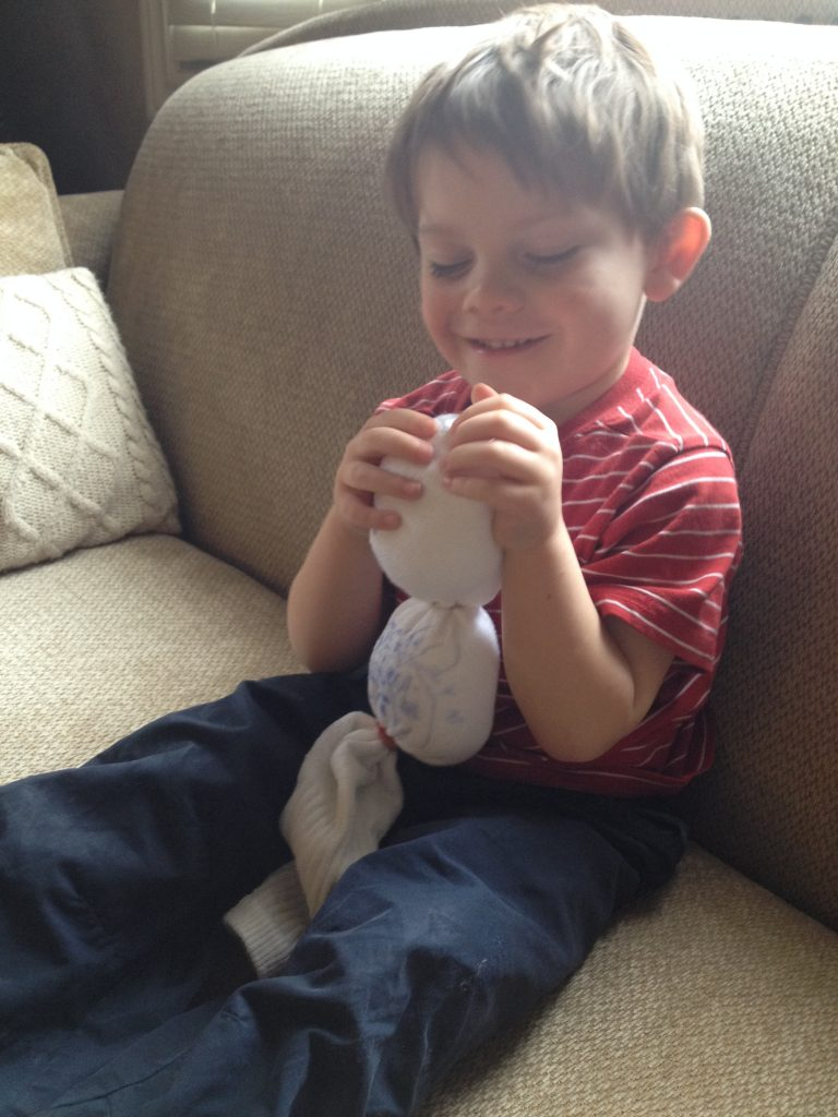 Happy with his olaf sock puppet - DIY Snowman Craft made by kids!
