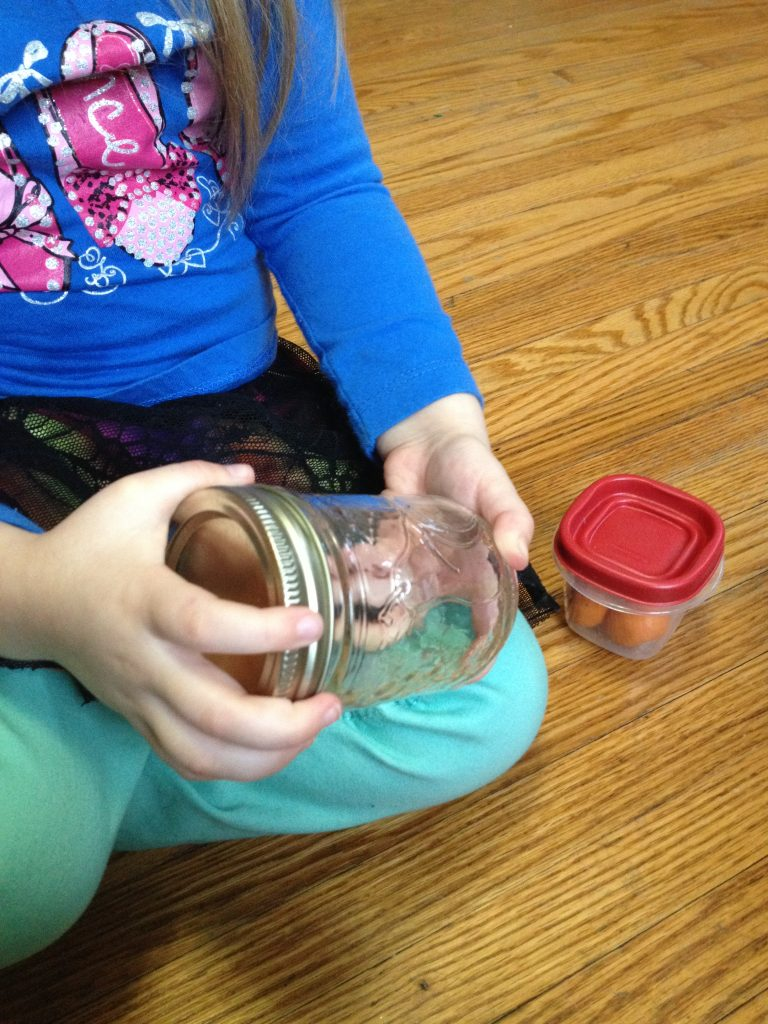 Montessori practical life lesson: Analysis of Movement, or opening and closing containers, allows children to think critically and use problem solving skills - as well as gross motor skills - to open and close various kinds of containers