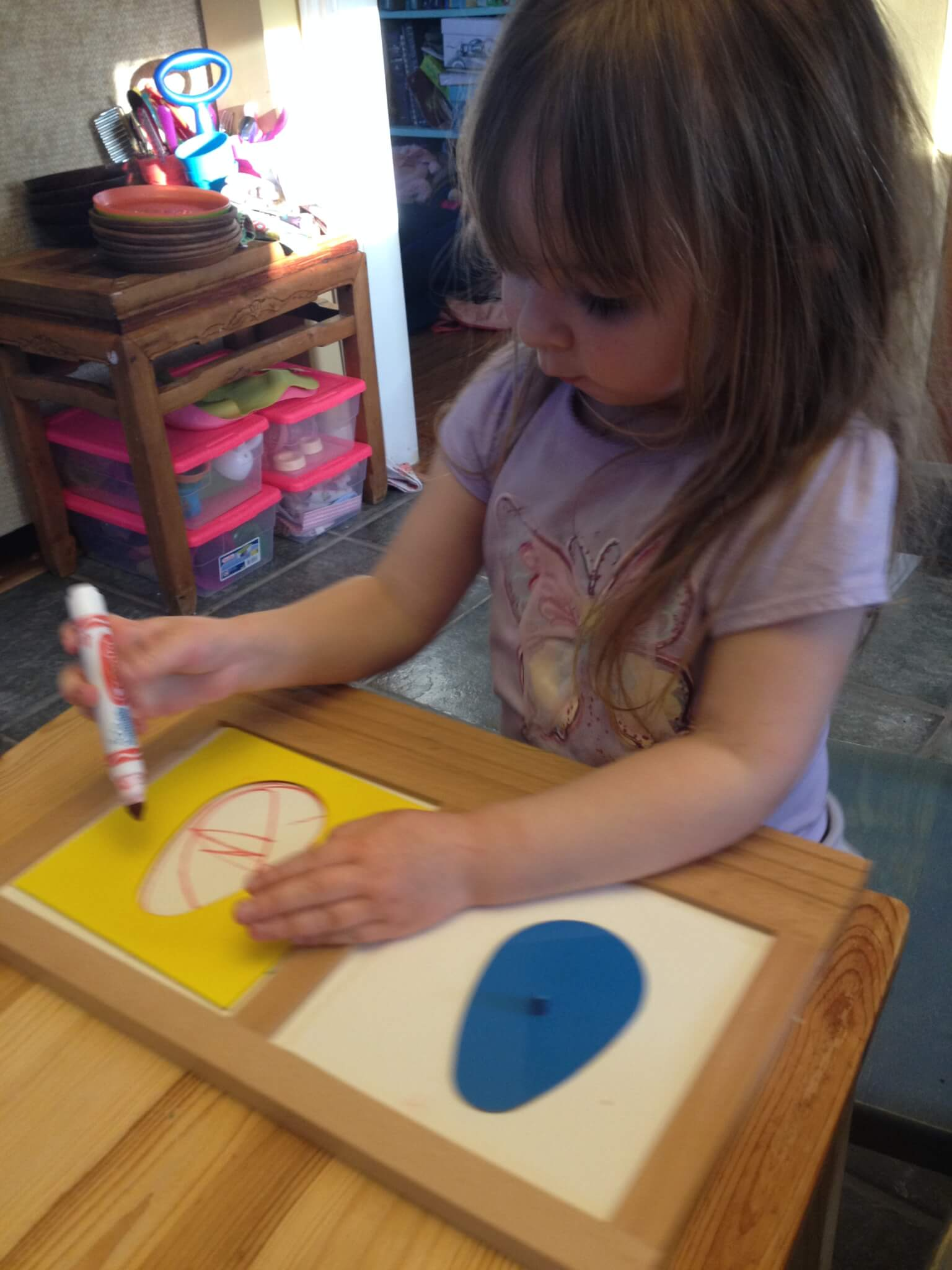 Using the Montessori metal insets for a fun Easter Egg craft