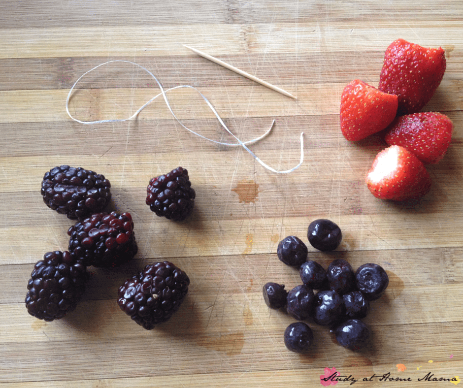 Materials to make your own berry bracelets - a great activity for kids in the kitchen, and a fun way to get them to eat their fruit. An easy snack for kids