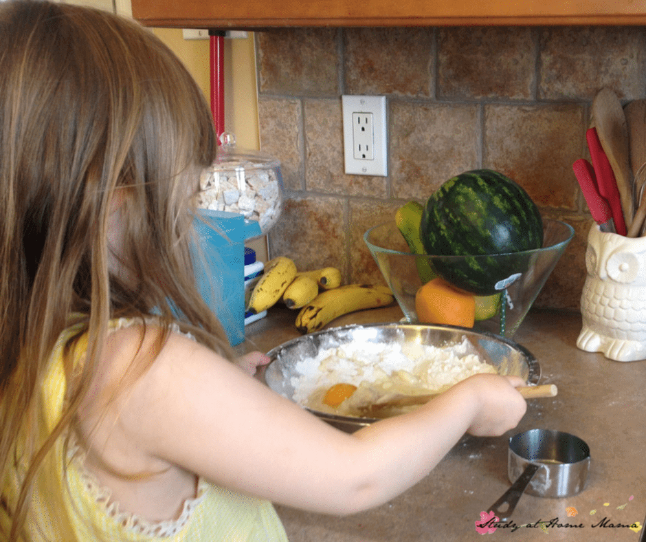 Ella making a pineapple upside down skillet cake