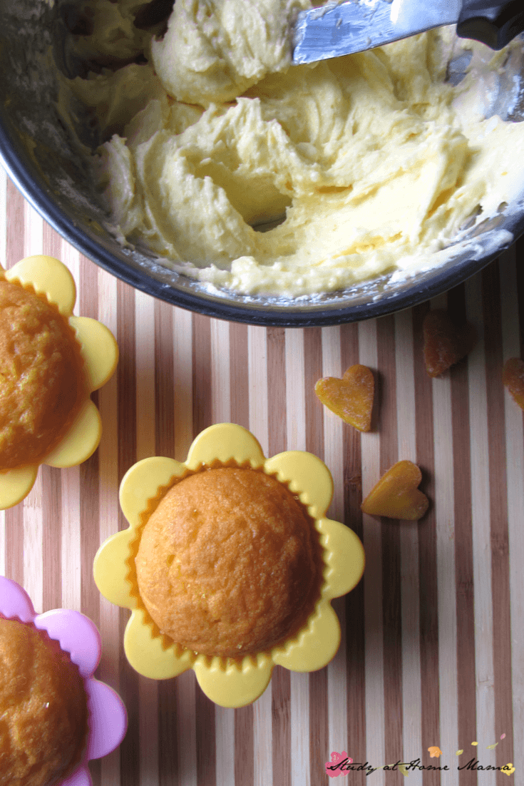 Fresh mango buttercream and dried mango decorations for these natural mango cupcakes