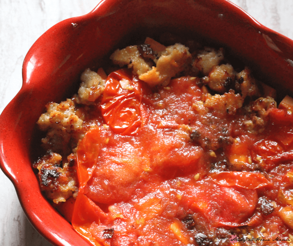 Homemade roasted tomatoes top off the sausage layer in this healthy breakfast casserole