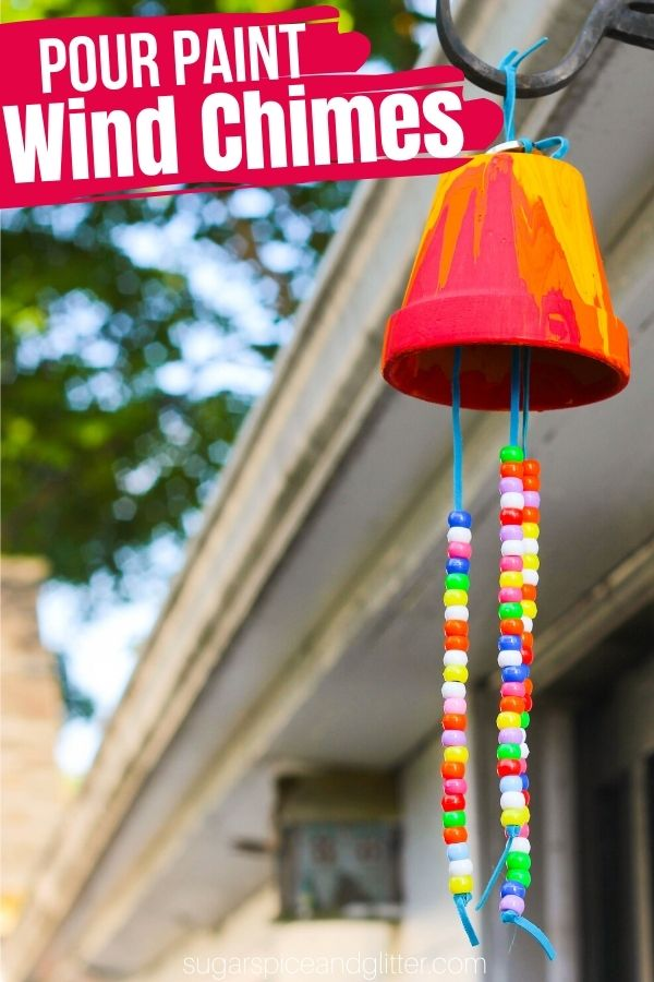A fun process art craft for kids that results in a beautiful homemade wind chime, these Garden Wind Chimes use an old potting plant, almost-finished bottles of paint and whatever pretty things you have lying around