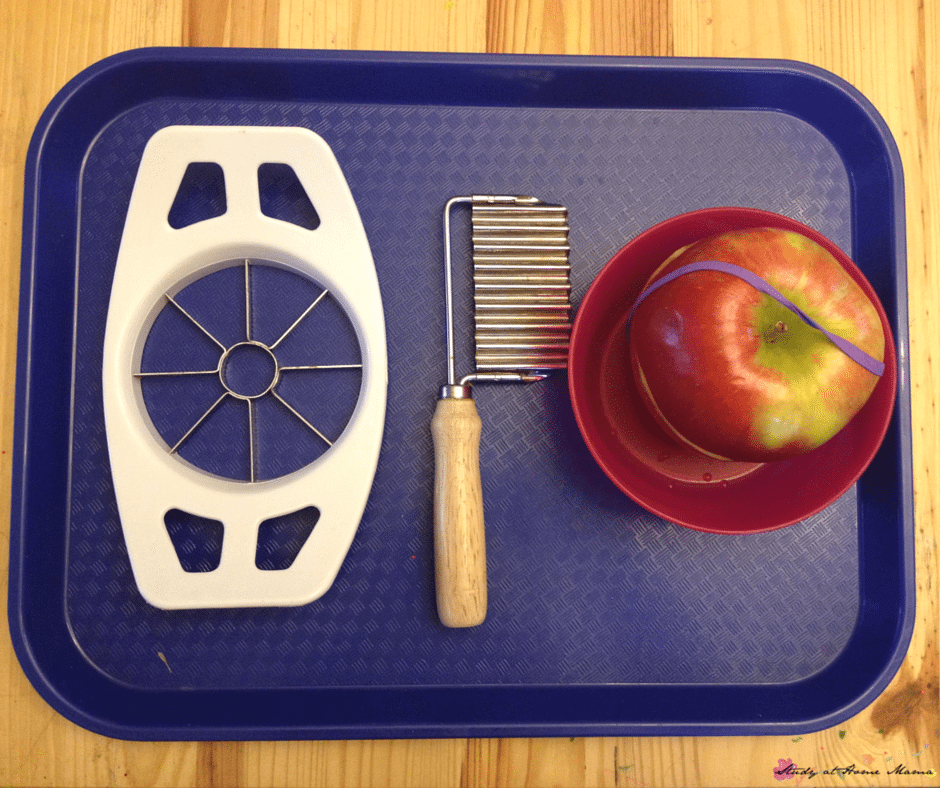 Apple cutting tray set-up used in the Montessori lesson for cutting an apple