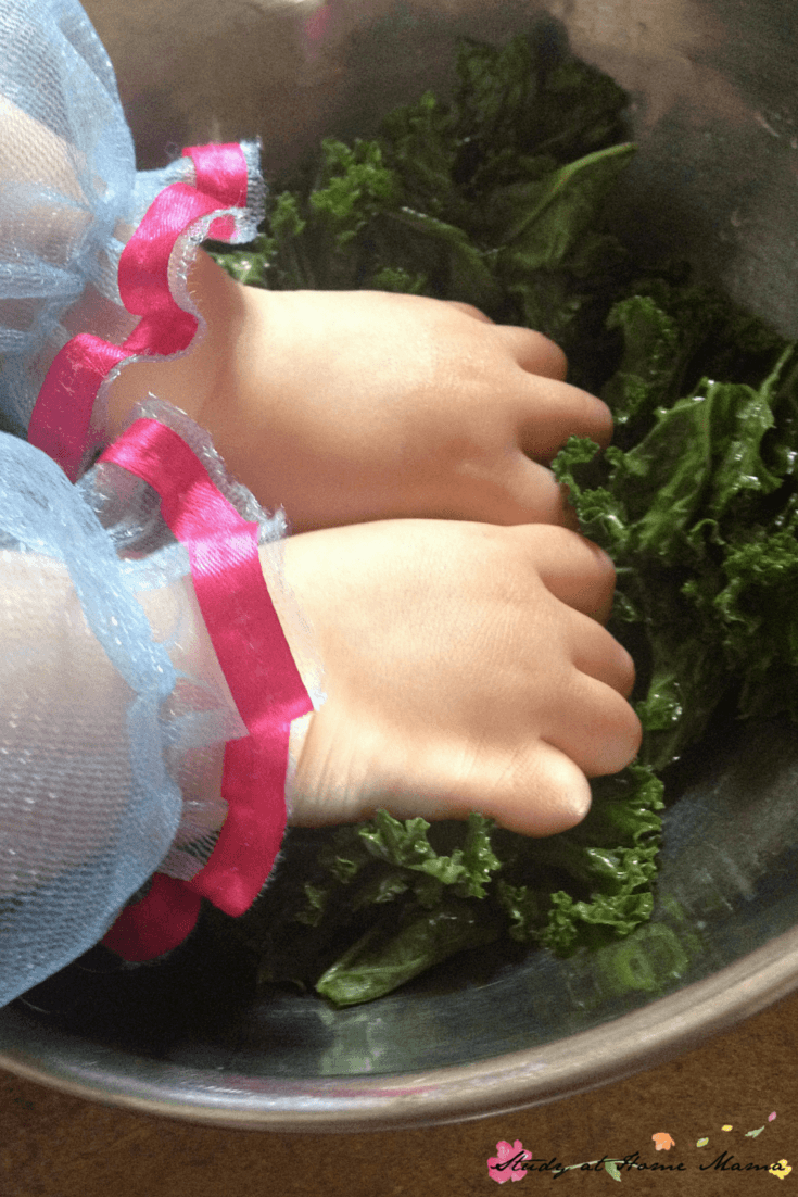 Kids Kitchen: Kale Chips - squishing the oil onto the kale for homemade kale chips is a great sensory activity for kids