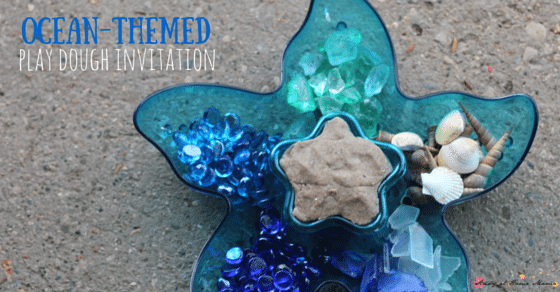 Ocean-themed Play Dough Invitation uses seashells, seaglass, and aquarium pebbles to encourage kids to explore early math and literacy concepts while engaging in a fun sensory activity for kids!
