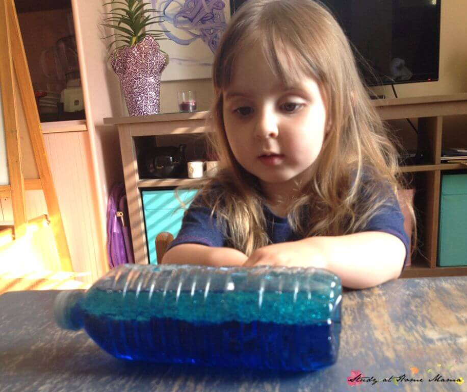 Make your own wave in a bottle science experiment using oil and water!