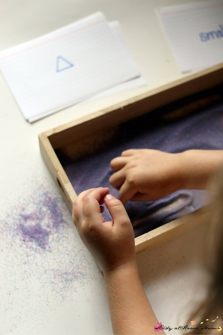 Where the Wild Things Are Book Activity: tracing shapes in the Montessori Sand tray - bigger and smaller prompts