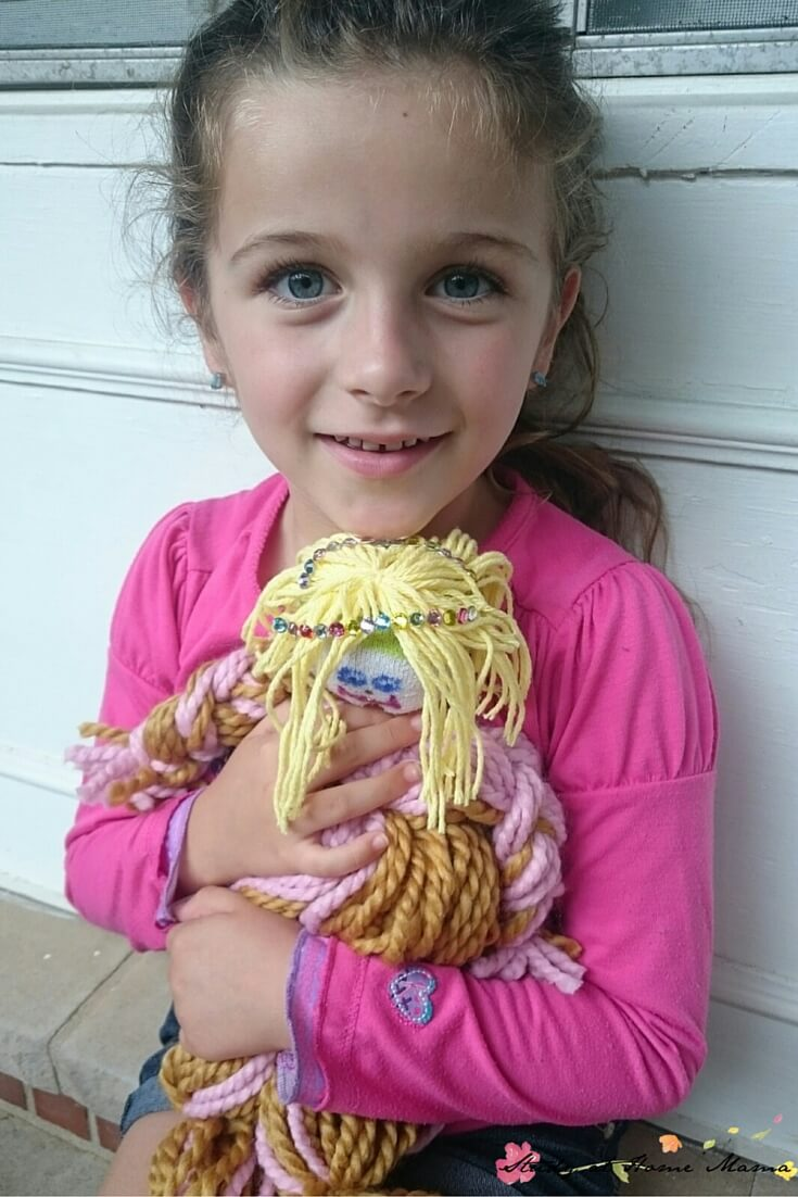This little girl is so proud of her homemade mop doll! They are so easy to make and kids will feel so proud of making their own dolls. Click through to the blog post for full directions and materials needed.