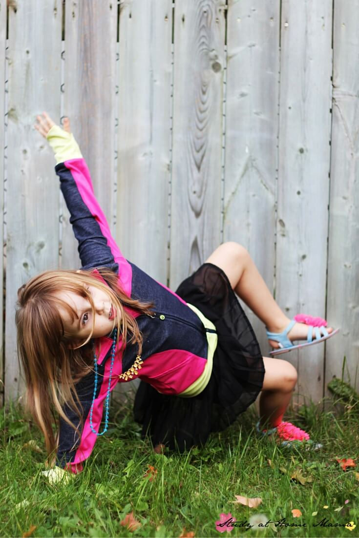Modified triangle or side plank pose for kids, part of a fall themed yoga for kids sequence