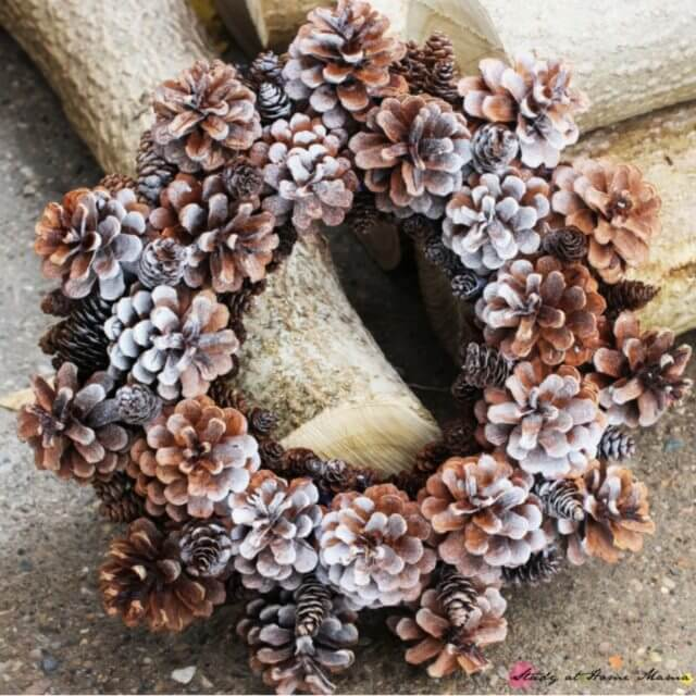 "Easy kids craft idea - a winter pine cone wreath with a light spritz of ""frost"""