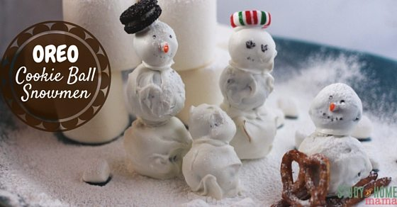 OREO Cookie Ball Snowmen - a fun twist on a classic Christmas cookie. Make a winter scene with the kids - a marshmallow igloo, a pretzel sled, the sky's the limit. Use flavoured OREOs for an extra holiday twist.